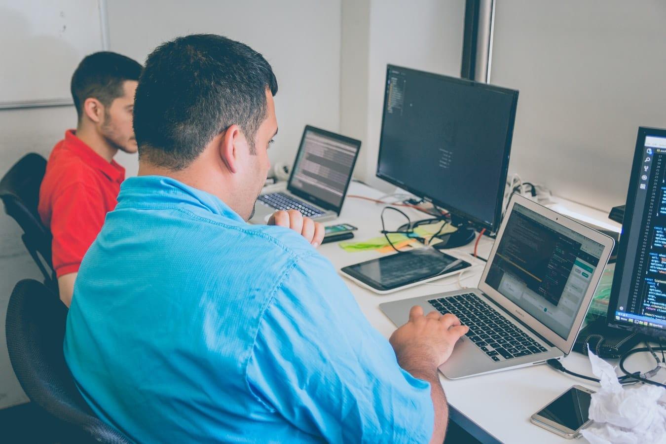 guys-working-on-laptops